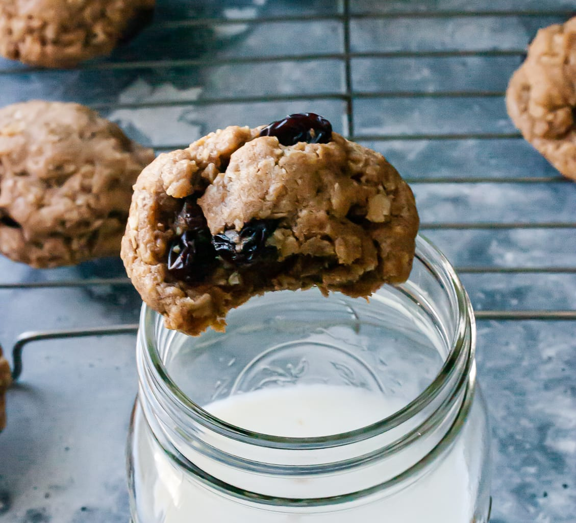 Oatmeal Raisin Cookie placed on a glass of milk