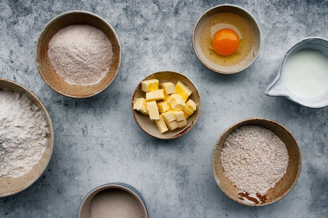 Scone ingredients placed in different size bowls