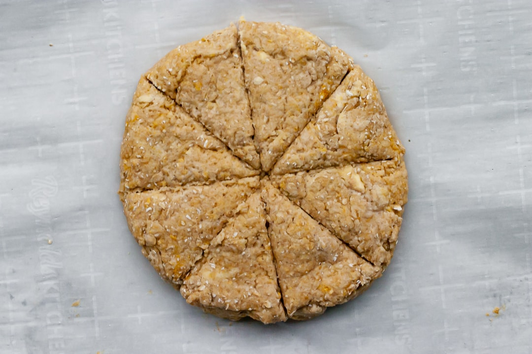 Scone dough shaped in a circle and cut into 8 wedges