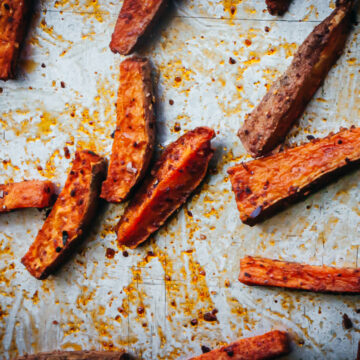 Cooked Oven-Baked Sweet Potato Fries on a baking sheet