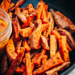 Oven-Baked Sweet Potato fries layered in a serving bowl