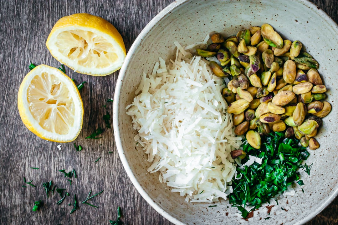 pistachios, cheeses, and herbs in a bowl
