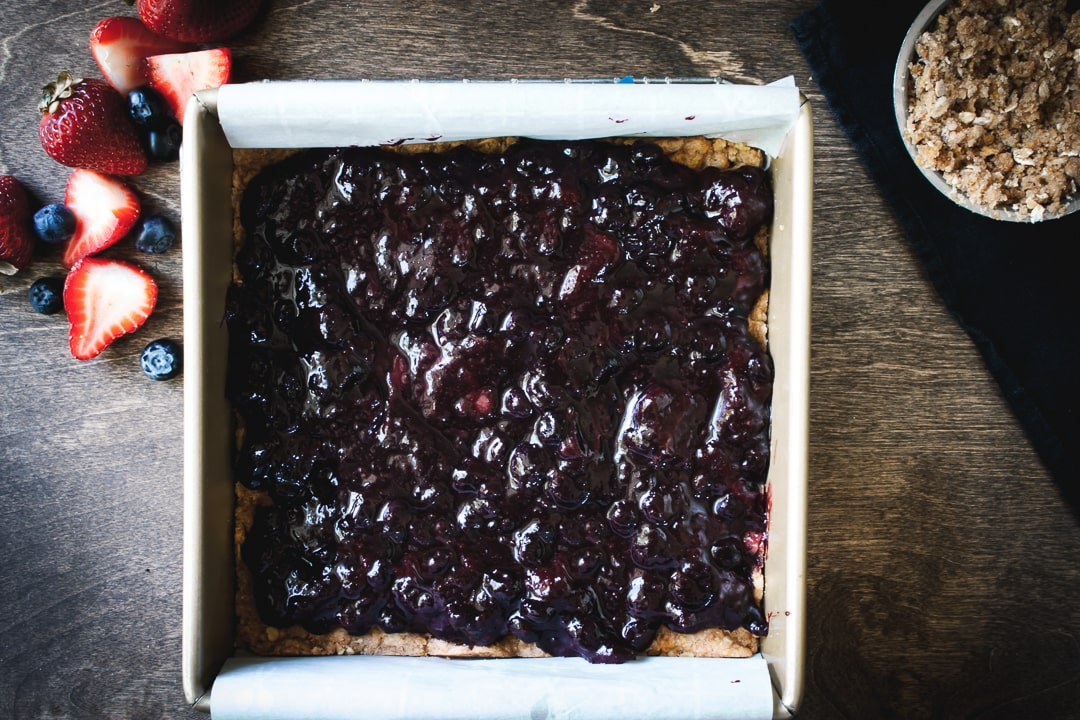 jam layered evenly on the crust in a baking pan