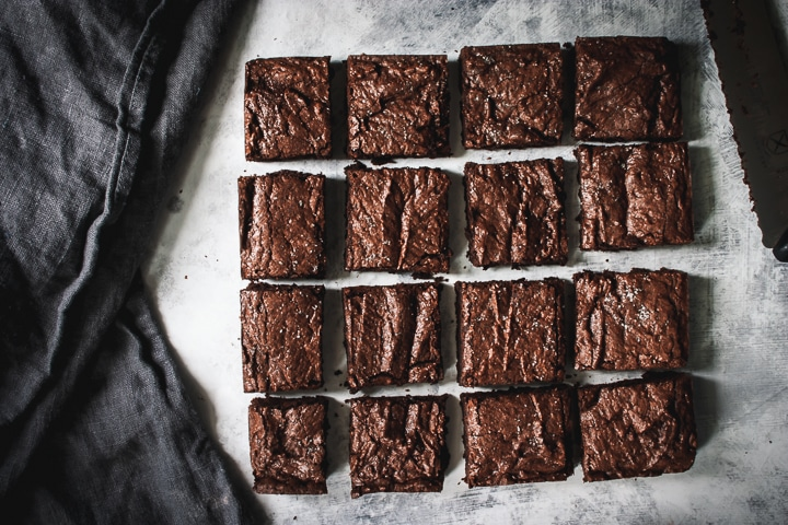 brownies cut into 16 squares after baking with a napkin on the side
