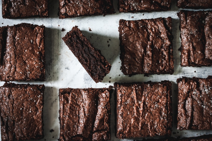 bittersweet salted rye brownies cut into squares with one brownie side-up