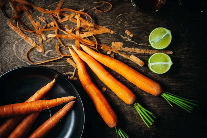 carrots with peels with limes on the side