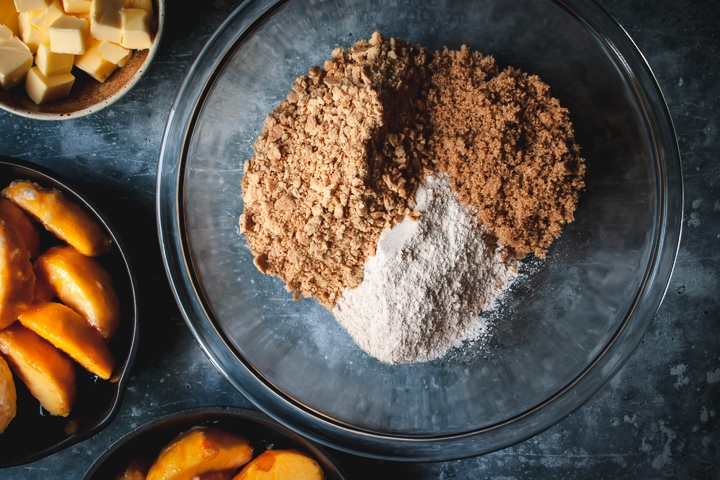 dry ingredients for crumble in a bowl with butter on the side