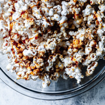 homemade salted caramel popcorn in a glass bowl